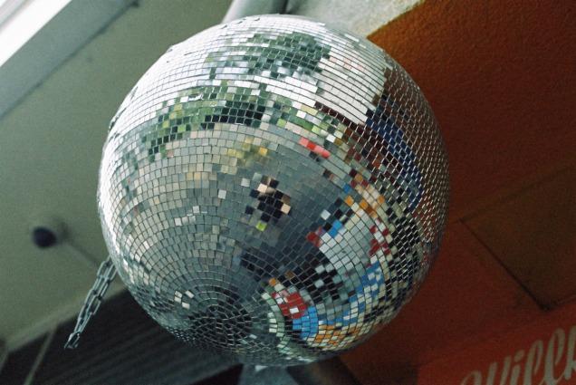A self portrait reflection in a disco ball.