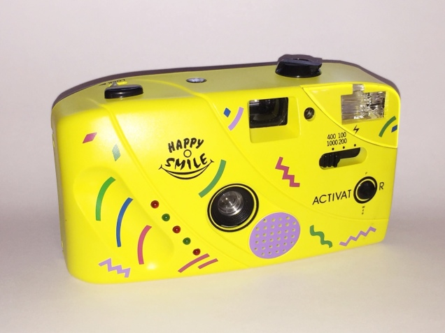 A plastic yellow toy camera.