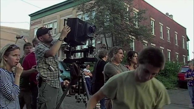 Gregory Crewdson, directing the scene from in front of the camera.