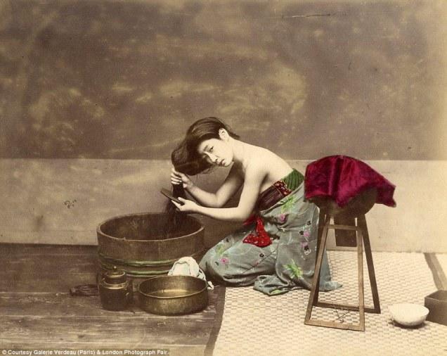 Woman combing her hair by Felice Beato (photo taken between 1863-1877).